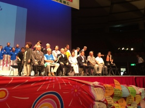 A group of hibakusha on stage at the World Conference